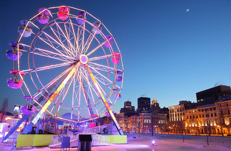 A ferris wheel lit up at night in Old Montreal, Quebec