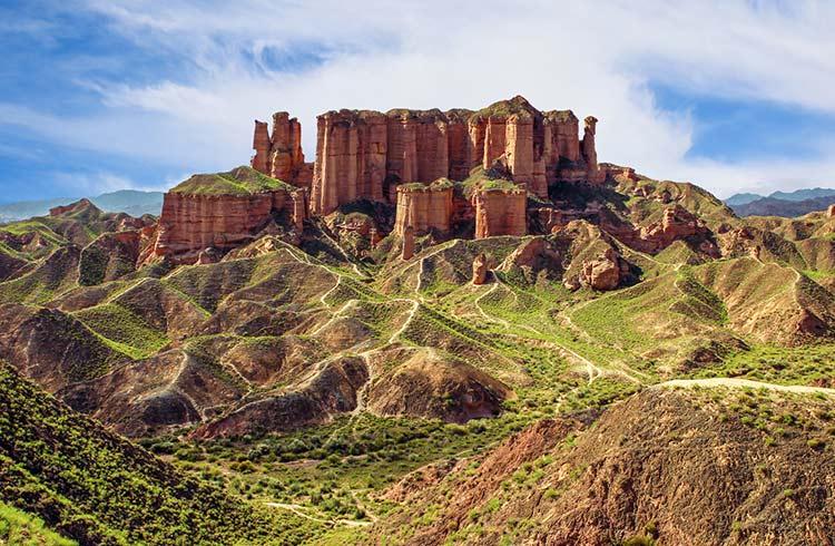 Towering landforms over a vast landscape in Gansu
