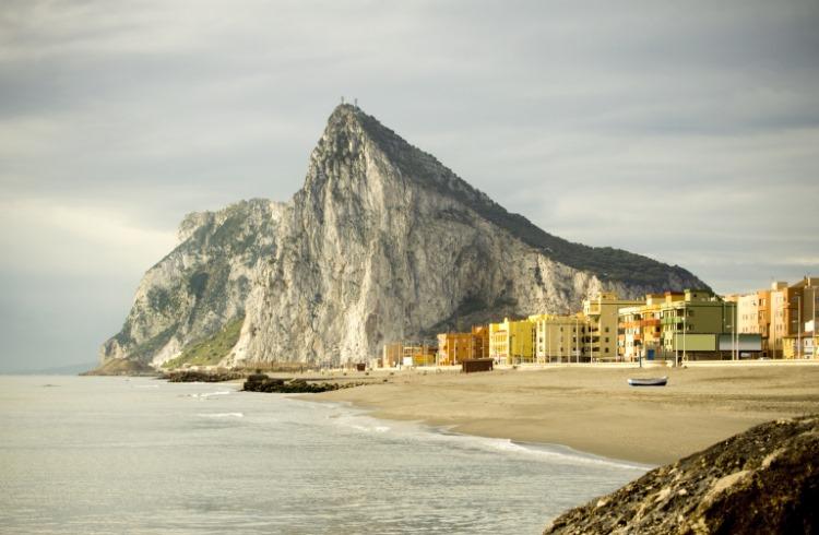 The Rock of Gibraltar looms above a beach in Cadiz, Spain.