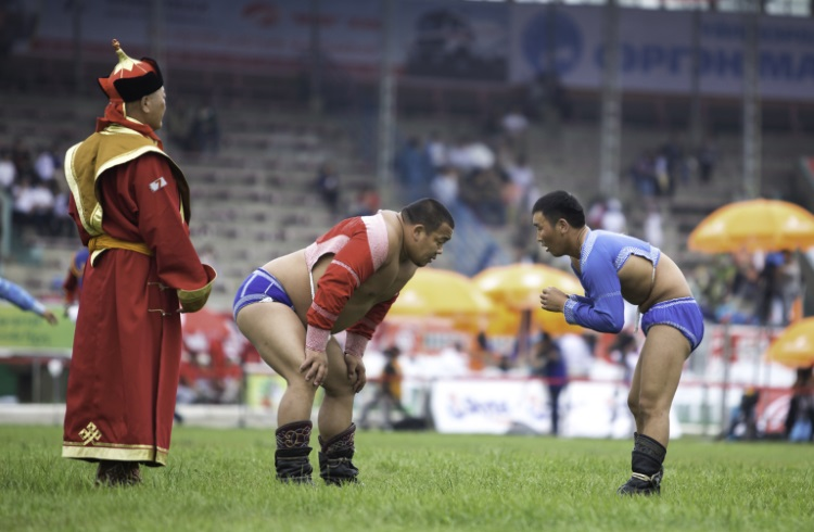 Wrestlers at the Naadam Festival, Outer Mongolia.