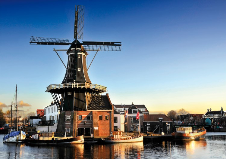 The iconic Adriaan Windmill on the riverfront in Haarlem, the Netherlands.