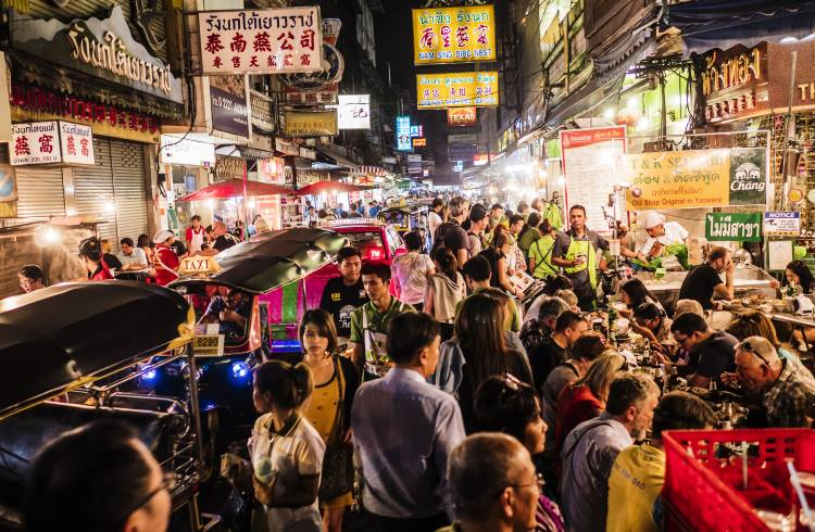 Crowds of shoppers and diners at the night market in Bangok's Chinatown.