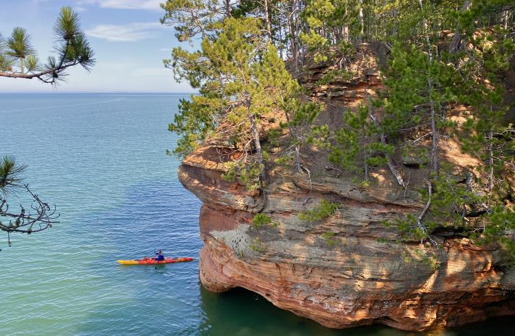 Kayakers on Lake Superior below the Myers Beach Sea Cave Trail in northern Wisconsin.