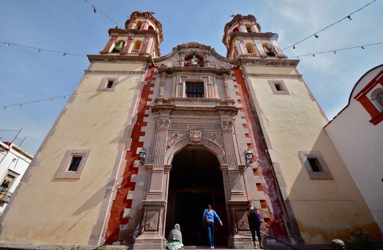 The ornate facade of a colonial church in Queretaro, Mexico.