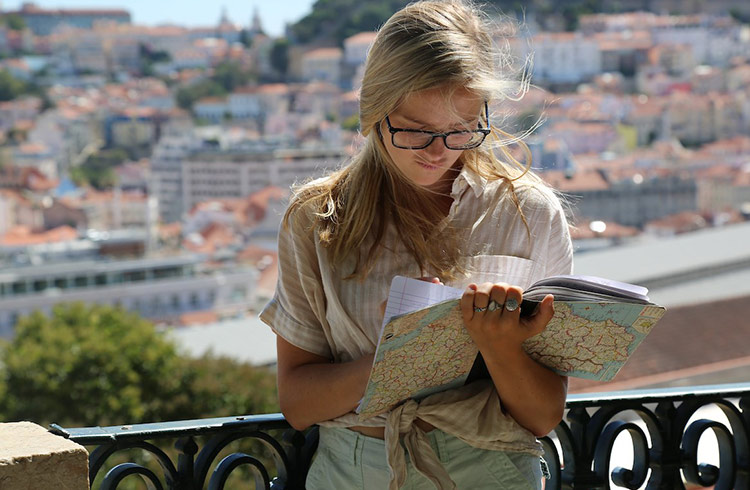 Woman writing in journal outdoors