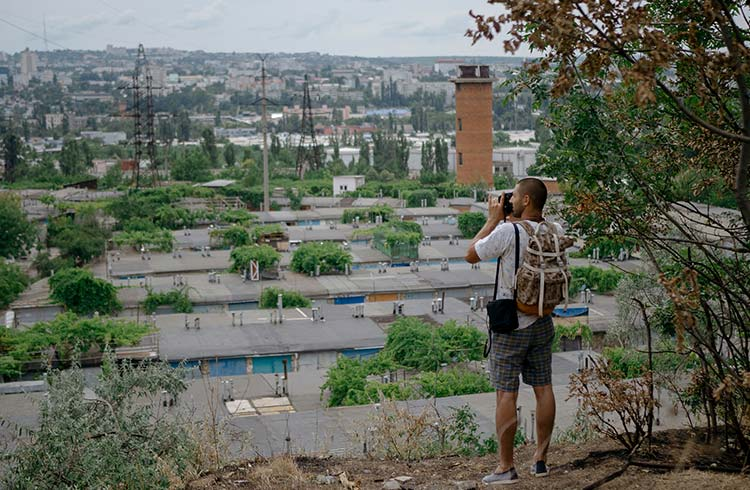 A man photographing the city of Chisinau, Moldova